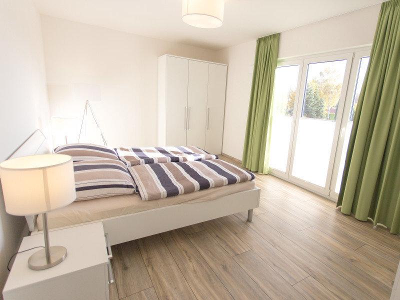 Große Schlafzimmer mit Doppelbetten
