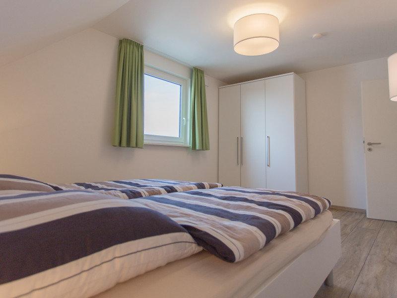 Jedes Schlafzimmer hat ein Doppelbett